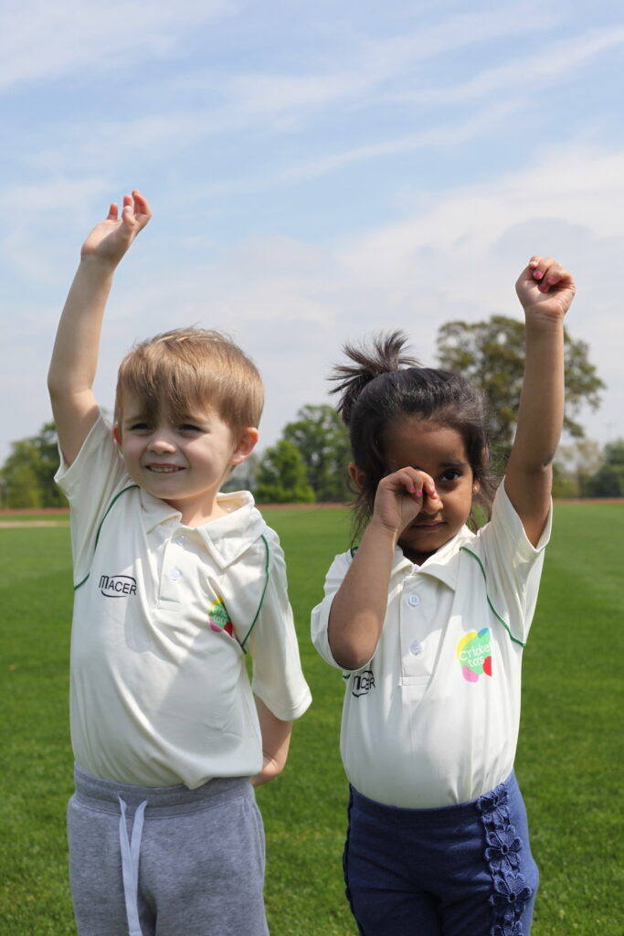 young boy and girl wearing white cricket tots t-shirt