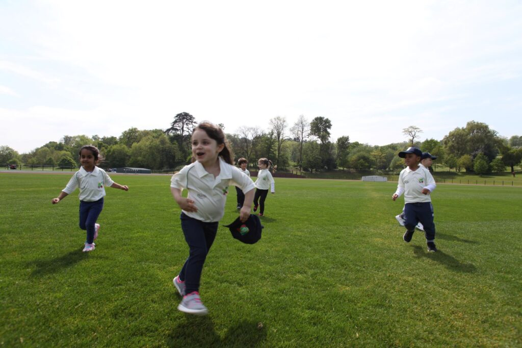 children running on cricket pitch